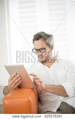An Handsome Man Surfing On A Tablet