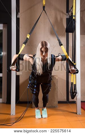 Beautiful Young Woman In Electrical Muscular Stimulation