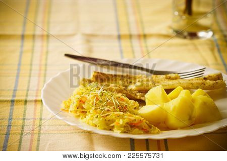 Food. Ready Delicious Dinner Fish Meat With Salad And Potatoes On Kitchen Home Table. Meal Time. Ind