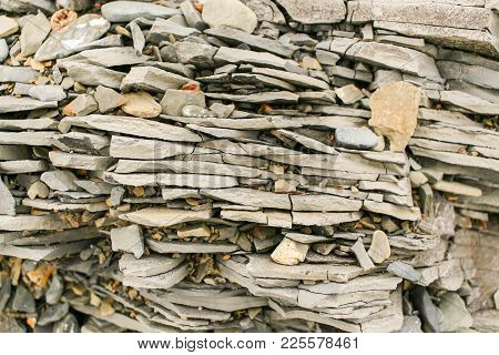 Natural Stone Background. Close-up Horizontal Layers With Shards Of Grey Mountain Slate.