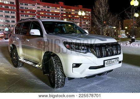 Novyy Urengoy, Russia - January 30, 2018: White Motor Car Toyota Land Cruiser Prado 150 In The City