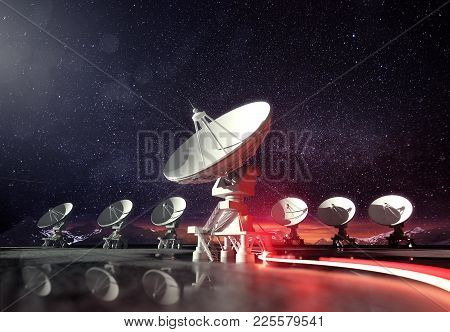 A Group Of Radio Telescopes At Night Glowing Under The Moonlight. Astronomy Background. 3d Illustrat