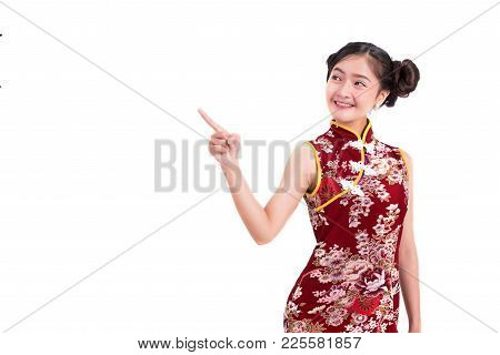 Young Asian Beauty Woman Wearing Cheongsam And Pointing Beside Gesture In Chinese New Year Festival