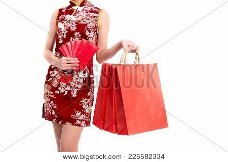 Lower Body Of Asian Beauty Woman Wearing Cheongsam And Carry Red Packet Of Money And Shopping Bag In
