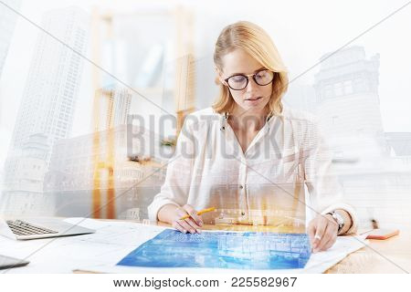 Diligent Worker. Close Up Of Bright Successful Engineer Working On New Project While Sitting At The