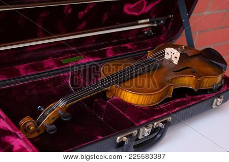 Violin And Bow In Dark Red Case.