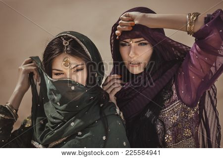 Travel Concept. Adventure Of Two Sisters Princesses In The Desert. Two Girls Have Got To A Sandstorm