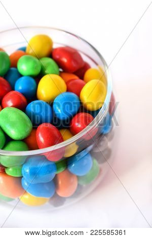 Multicoloured candies in a glass jar. Copy space