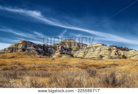 Rocky Formations Of The Badlands In South Dakota In A Brown Spring Time Landscape