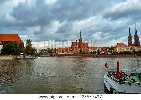 Wroclaw Old Town. Cathedral Island (ostrow Tumski) Is The Oldest Part Of The City At The Sunset. Cat