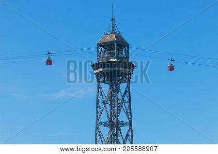 Car Of The Aerial Tramway Arriving At San Sebastian Tower, At The End Of The Ramblas. The Port Vell
