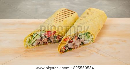Shawarma On A Wooden Board. Shown Ingredients.