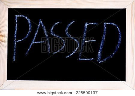Blackboard With White Chalk Writing Showing The Word Passed