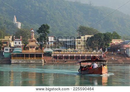 Rishikesh, India - November, 5th, 2017. Beautiful View Of Ganga River Embankment In Rishikesh. Peopl