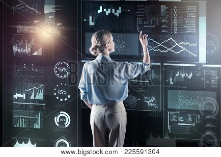 Attentive Woman. Clever Attentive Experienced Programmer Standing In Front Of A Big Futuristic Devic