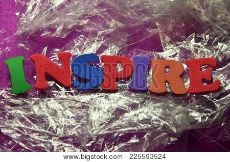 Word Inspire On An   Abstract Colored Background
