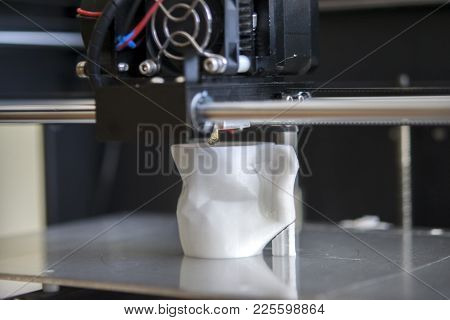 Objects Printed By 3d Printer. Automatic Three Dimensional 3d Printer Performs Plastic Modeling In L