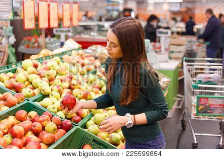 Young Woman Buy Apples In Farm Food Store.