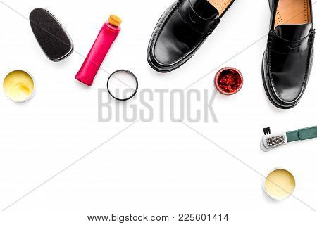 Shoe Care Products. Leather Men Shoes, Shoe Polish, Brushes, Wax On White Background Top View.