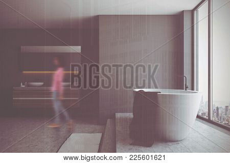 Black Bathroom Interior With A Concrete Floor, A White Tub, And A Double Sink. A Panoramic Window. 3