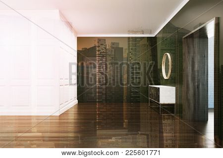 Empty Living Room Interior With White And Black Walls, A Wooden Floor And A Chest Of Drawers Near A
