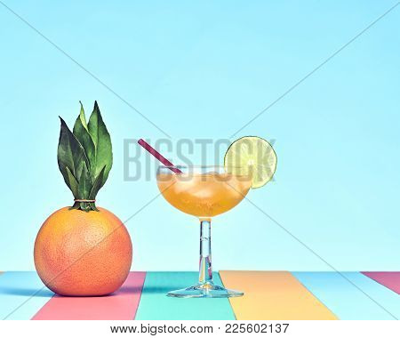 Tropical Grapefruit With Cocktail On Beach. Bright Summer Color. Trendy Fashion Style. Creative Art.
