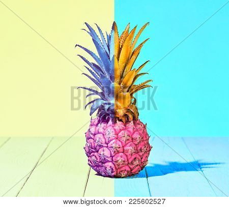 Tropical Pineapple Fruit. Bright Summer Color. Creative Minimal. Hot Summer Vibes. Pink Yellow Pinea