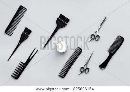 Beauty Saloon Equipment. Hairdress And Haircut. Combs, Sciccors, Brushes On Grey Background Top View