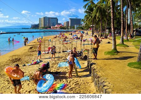 January 28, 2018 At Waikiki Beach In Honolulu, Hi:  Popular Crowded Beach Surrounded By Palm Trees,