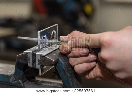 Craftsman Using A Round File Filing Holes In Acrylic Glass