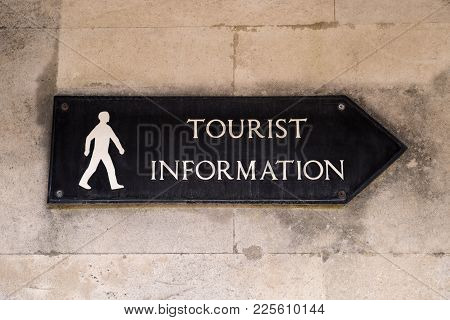 A Sign Showing The Direction To A Tourist Information.
