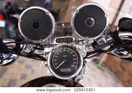 Steering Wheel With Music Speakers On A Motorcycle