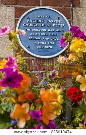 Dorset, Uk - August 16th 2017: A Blue Plaque Marking The Location Of The Ancient Parish Church Of St