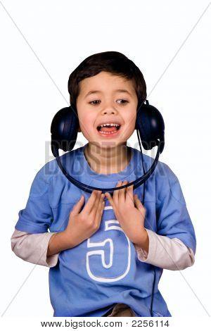 Young boy listening to headphones upside down