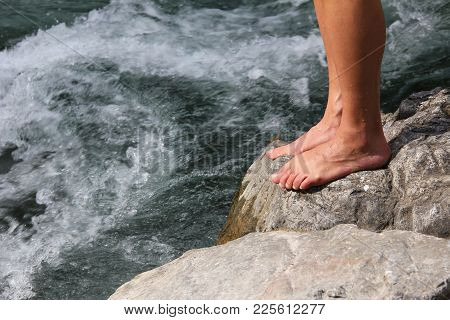 Mans Feet On A Stone In The River, Ready For Hardening With Kneippism