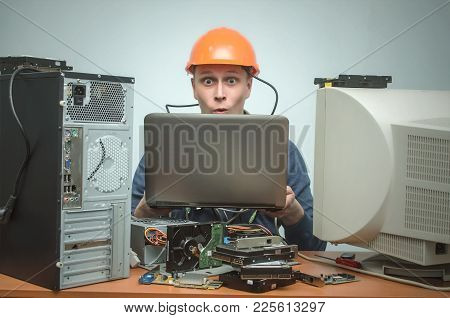 Surprised Computer Technician Work On Laptop Computer And Is Installing A New Software. Pc Repair Se
