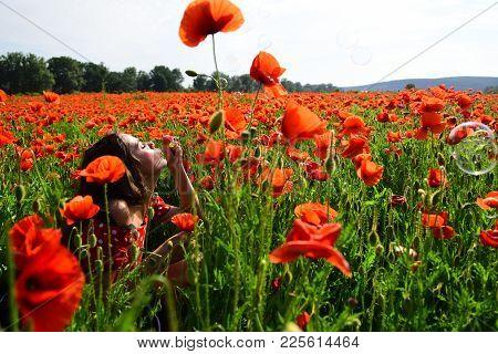 Woman Blow Bubble In Poppy Field, Dreams, Wishes. Summer, Spring, Poppy Flower. Opium Poppy, Youth,