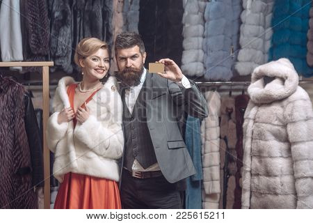Woman In Fur Coat With Man, Seller, Customer. Credit, Save, Shopping. Date, Couple, Love, Man And Wo