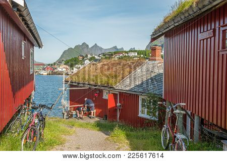 Reine, Norway - July 5, 2011: Typical Rorbu Cottages In Reine. These Traditional Seasonal Cottages U