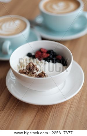 Breakfast. Cottage Cheese With Fresh Berries And Nuts, And Cappuccino