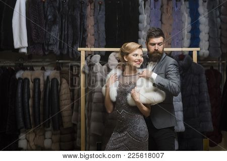 Couple In Love Among Fur Coat, Luxury. Date, Couple, Love, Man And Woman. Woman In Fur Coat With Man