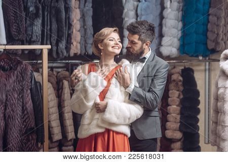 Purchase, Shopping, Seller And Customer. Purchase, Couple In Love Buy Fur Coat, Man And Woman.