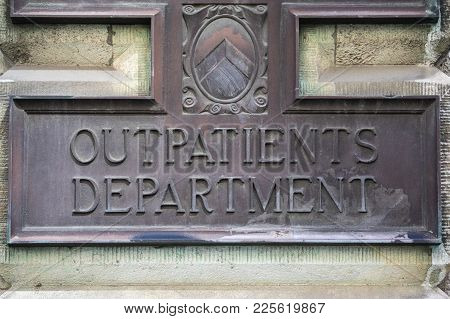 London, Uk - August 11th 2017: A Metal Plaque At The Outpatients Department At St. Bartholomews Hosp