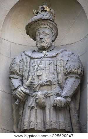 A statue of King Henry VIII located above the Henry VIII Gate at St. Bartholomews Hospital in the City of London.  It is the only statue of Henry VIII on public display in London. poster