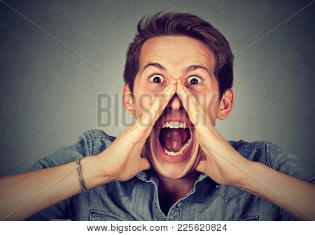 Headshot Displeased Angry Man Screaming Isolated On Gray Background