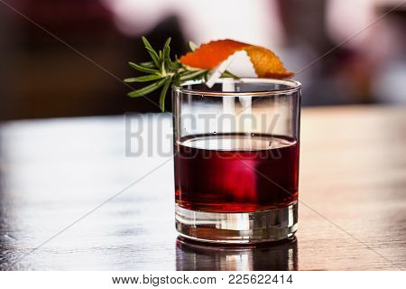Cocktail With A Sprig Of Rosemary, Sloe Up