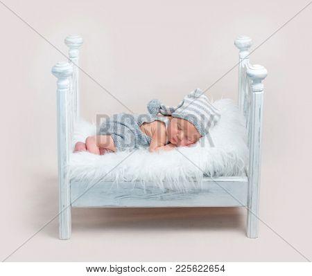 Sweetly sleeping baby in the crib