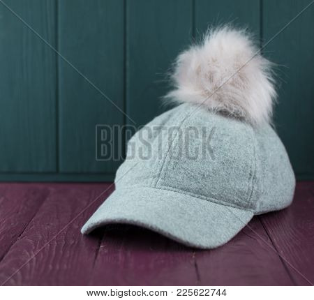 Gray Baseball Cap From A Coat Fabric With A Pink Pompon