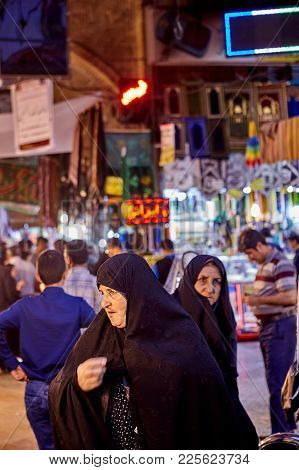 Tehran, Iran - April 27, 2017: Crowd Of Muslim People Inside Oriental Bazaar In Shahre Rey Area, Teh