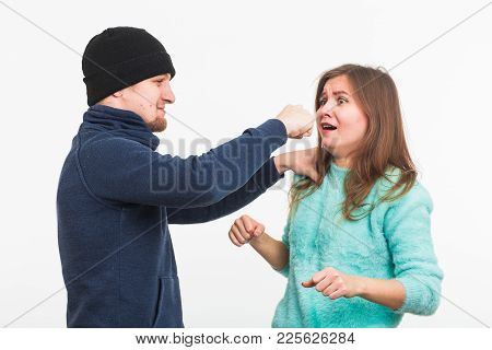 Woman Victim Of Violence And Abuse. Criminal Man Beats A Woman.